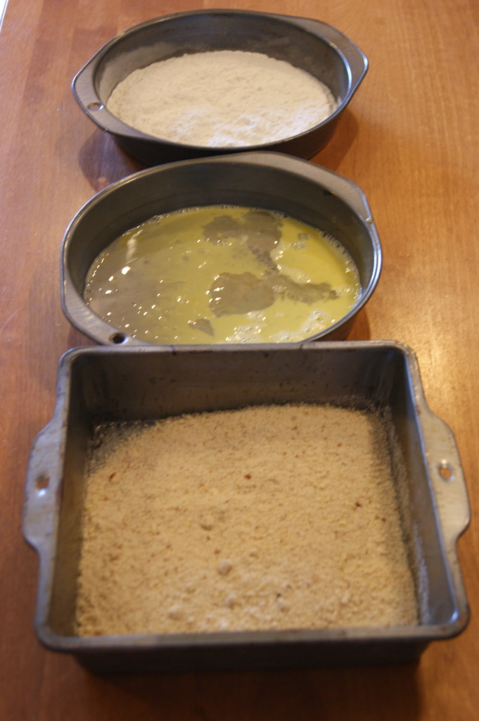 Classic three step breading process.  Dredge the fish in the flour, then egg and finally the almond-Parmesan bread crumb mixture.  Dry, wet, dry.