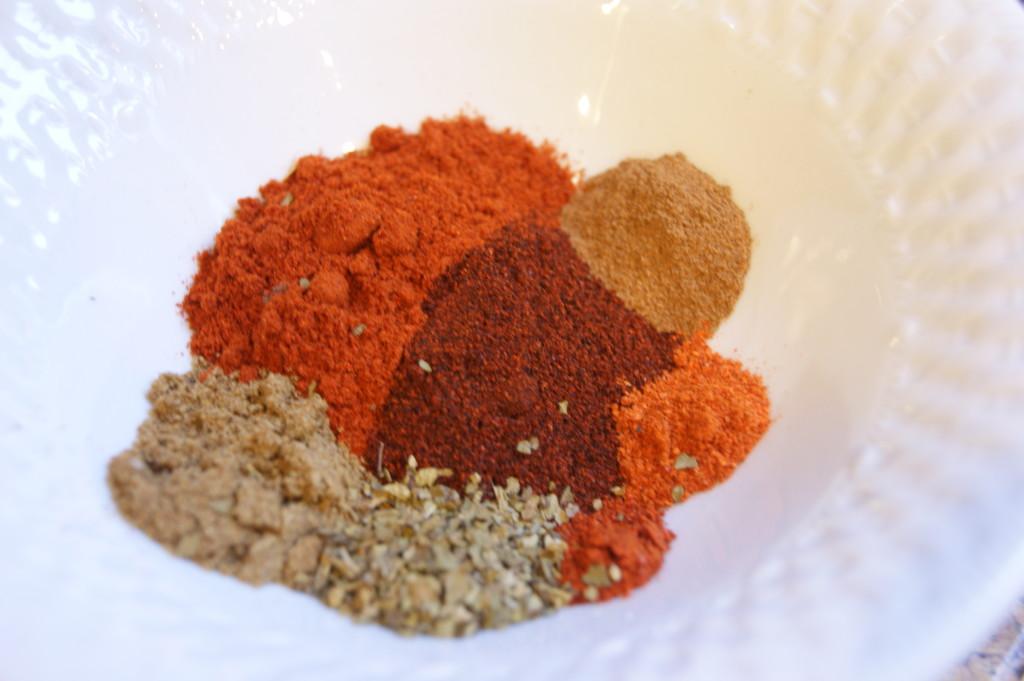 Mexican oregano, pequin chili powder, ancho chili powder, paprika, cumin, cayenne and cinnamon.
