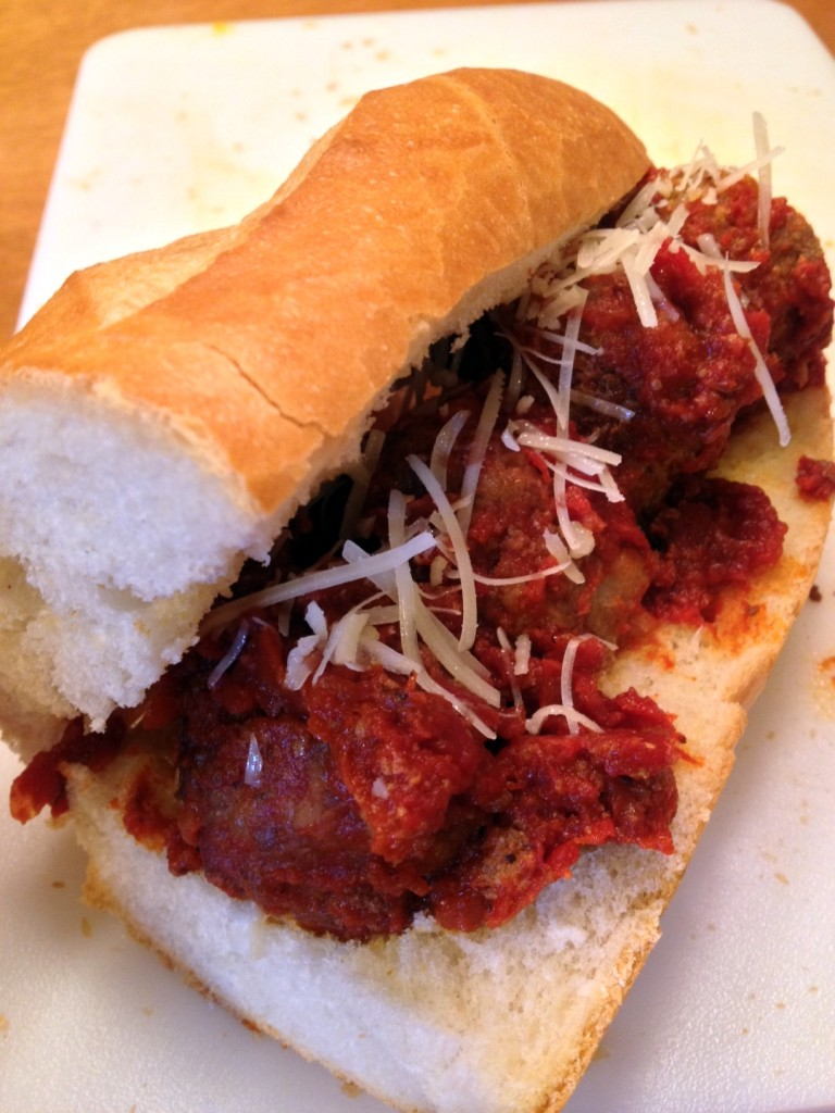 Great as a sub.  Split french bread length wise and slather on some butter.  Sprinkle with some garlic powder and freshly grated Parmesan cheese.  Toast in a 350 degree oven until crispy.  Top with meatballs and more cheese.