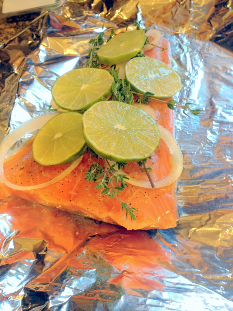 Add the sliced lime and seal the foil to form a pouch - this keeps the fish super moist throughout the cooking process.