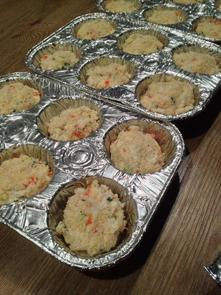 I breaded and formed the crab cakes and put them into buttered muffin tins.  Then, I topped them with a few pats of butter.  The client warmed the crab cakes in the oven until golden brown and topped with remoulade sauce.  Easy peasy.