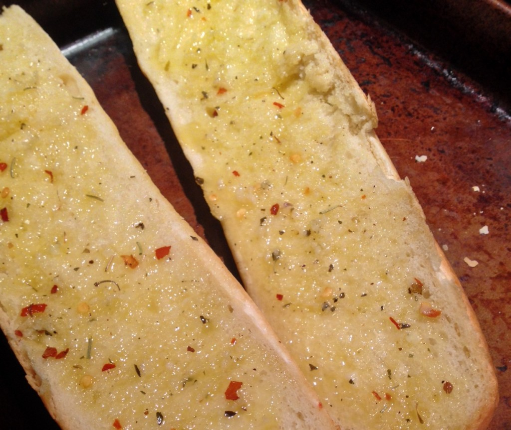 Spread butter and herb mixture onto bread before toasting.