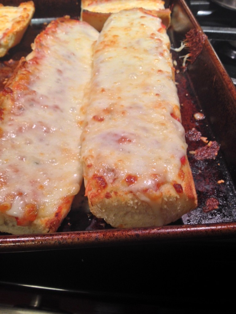 After toasting the bread, remove from oven, add the sauce and cheese.  Back into the oven a bit more and this is what it'll look like when you take it out.