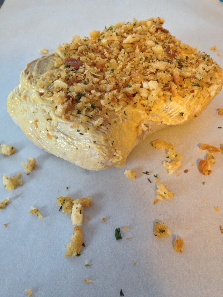 Sear the pork, saute the herbs and breadcrumbs and coat pork with Dijon and apply herb breadcrumbs...
