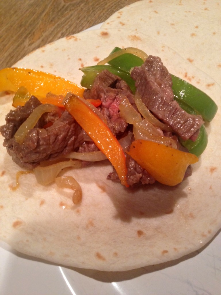 Warm, soft flour tortillas topped with tender steak and veggies.