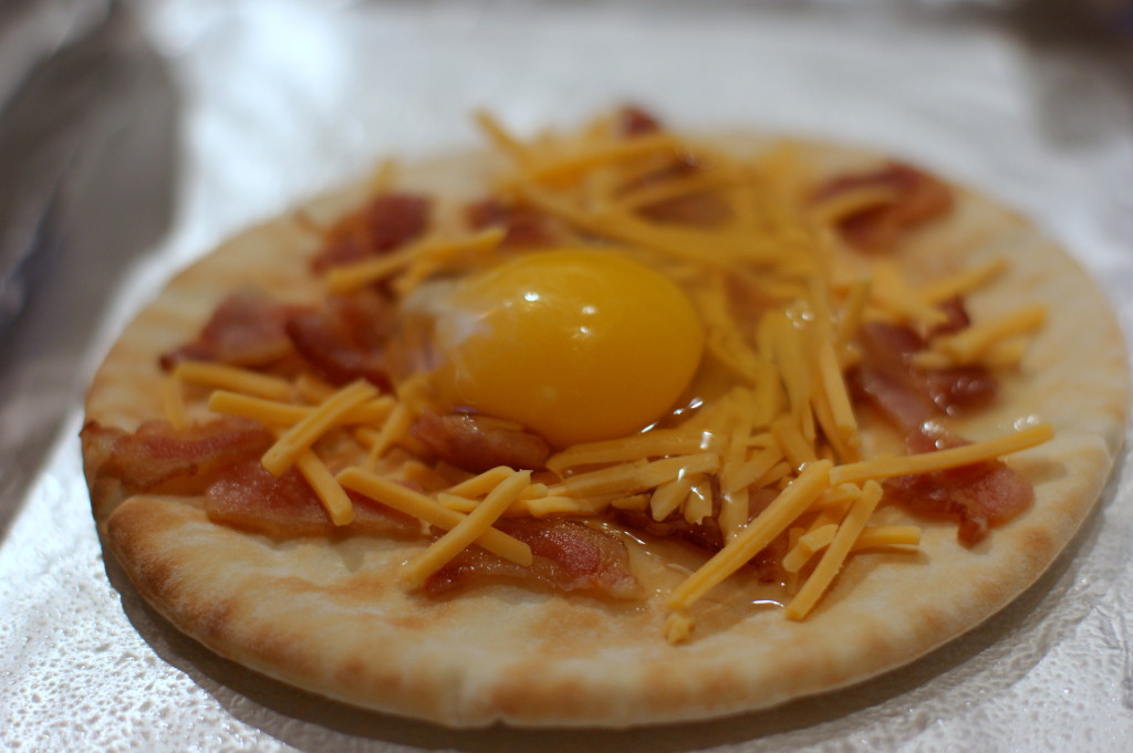 Crack each egg into a bowl before adding to the pita to make sure your pizzas are eggshell free!
