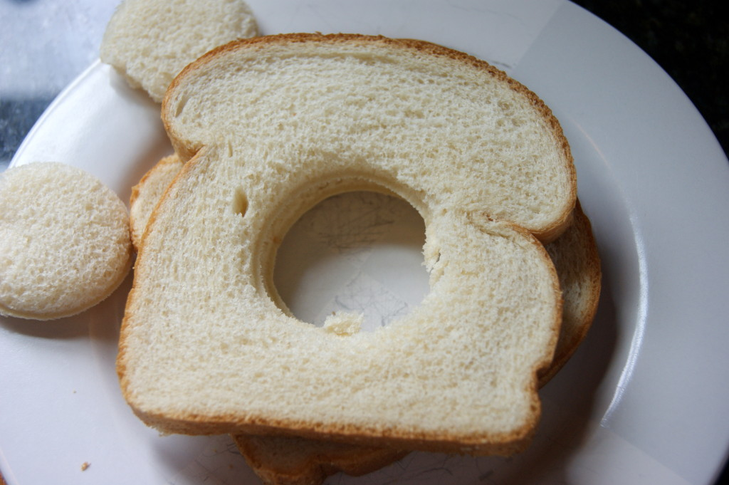 Use a shot glass or biscuit cutter to cut a hold in the bread...